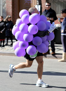 marathon runner dressed as a grape