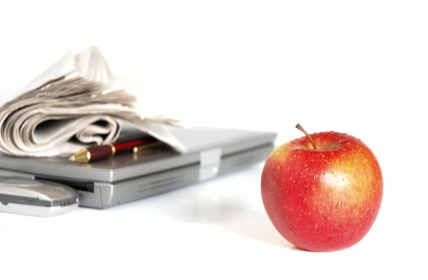 Apple_and_laptop_with_papers